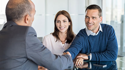 Businessman shaking hands with clients