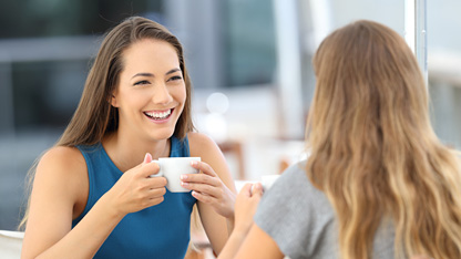 Happy women drinking coffee