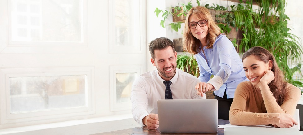 Mortgage Broker showing clients information on laptop
